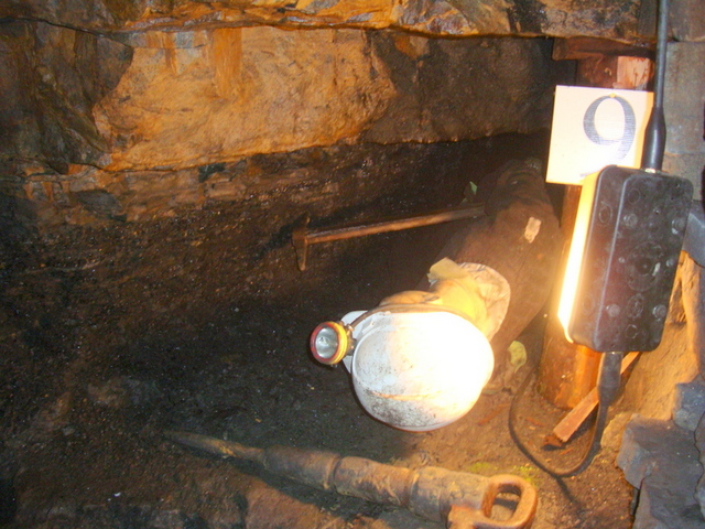 working conditions of the miners; a two foot seam of coal only accessible by the miner lying on the ground